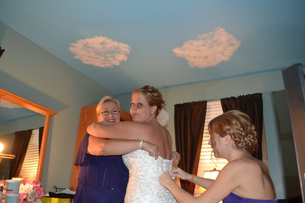 I helped lace up my sister's wedding dress. I made sure she couldn't breathe by the time I was done! (This is an Emma cam angle by the way)